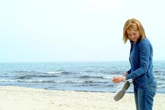 Young woman at seaside - stock photo