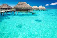Water villas in the ocean with steps into lagoon Stock Photos