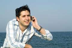 Stock Photo of Young man talking on cell