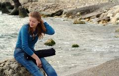 Stock Photo of Young woman at seaside