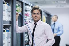 it enineers in network server room - stock photo