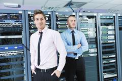Stock Photo of it enineers in network server room