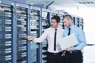 Stock Photo of it enineers in network server room