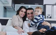 Happy young family have fun  at home Stock Photos