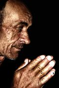 Stock Photo of old man praying