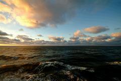 Stock Photo of Sunset across sea