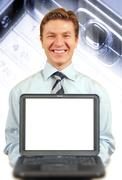 Stock Photo of young businessman presenting a laptop