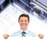 Stock Photo of young businessman holding a white board