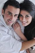 happy young couple relax at home - stock photo
