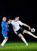 Football players in action for the ball Stock Photos