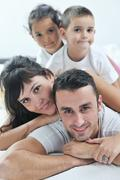 Happy young family in their bedroom Stock Photos