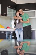 young couple have fun in modern kitchen - stock photo
