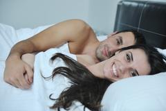 Young couple have good time in their bedroom Stock Photos