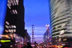 city night with cars motion blurred light in busy street - stock photo
