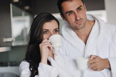 young love couple taking fresh morning cup of coffee - stock photo