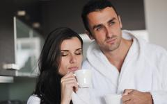 Young love couple taking fresh morning cup of coffee Stock Photos