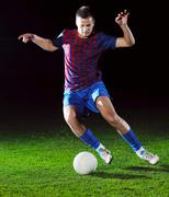 Football player in action Stock Photos