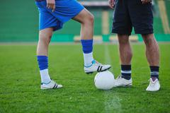 Stock Photo of football players in competition for the ball