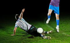 football players in competition for the ball - stock photo