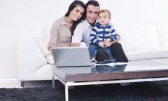 happy young family have fun  at home - stock photo