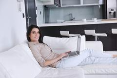 woman work on laptop at home - stock photo