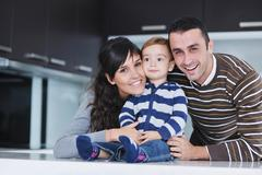 Stock Photo of happy young family have fun  at home