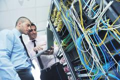 Stock Photo of it engineers in network server room