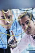 it engineers in network server room - stock photo