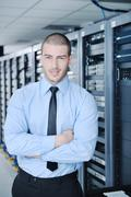 Young it engineer in datacenter server room Stock Photos