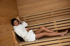 Stock Photo of young woman take a steam bath