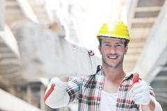 Hard worker on construction site Stock Photos