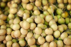 Longan fruit on the counter of the asian market Stock Photos