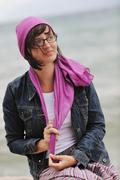 beautiful young woman on beach with scarf - stock photo