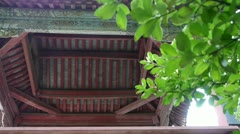 Chinese ancient building eaves,Roof tiles & tree leaves. Stock Footage