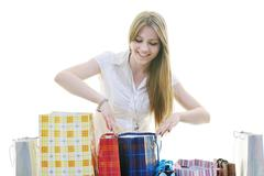 happy young adult women  shopping with colored bags - stock photo