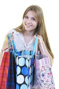 Stock Photo of happy young adult women  shopping with colored bags