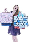 Happy young adult women  shopping with colored bags Stock Photos