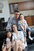 young family at home - stock photo