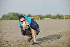 Amateur photographer taking snapshot photo Stock Photos