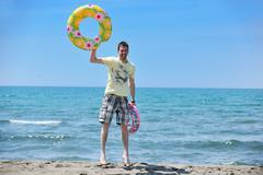 man relax on beach - stock photo