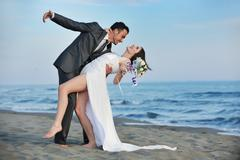 romantic beach wedding at sunset - stock photo