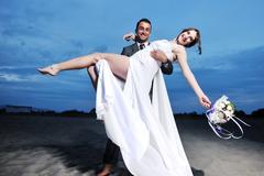 Stock Photo of romantic beach wedding at sunset