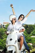 Stock Photo of portrait of happy young love couple on scooter enjoying summer time