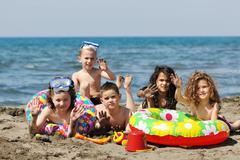 child group have fun and play with beach toys - stock photo