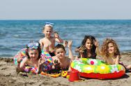 Stock Photo of child group have fun and play with beach toys
