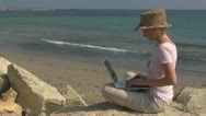 Business woman working on laptop on the beach, busy, holiday, ocean, woman, girl Stock Footage