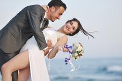 romantic beach wedding at sunset - stock photo
