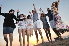 group of young people enjoy summer  party at the beach - stock photo