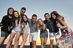 Group of young people enjoy summer  party at the beach Stock Photos