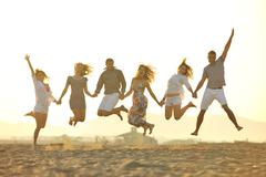 Stock Photo of happy young  people group have fun on beach
